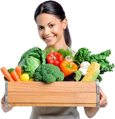 Image of Woman Holding a Box Full of Different Vegetables - Freedom Health Centers